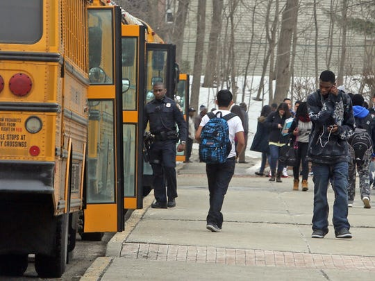 Police were on hand outside Spring Valley High during dismissal Tuesday. The school was put on lockdown earlier in the day after a dispute between two students led to a stabbing.