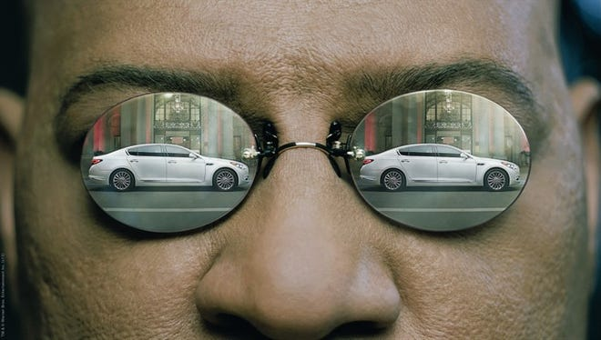 Kia's K900 reflects in the glasses worn by Laurence Fishburne in the brand's Super Bowl ad
