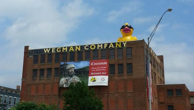A big rubber duck sits atop the Wegman building to promote the upcoming rubber duck regatta.