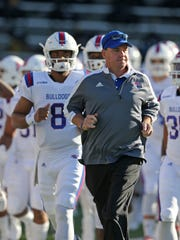 Louisiana Tech coach Skip Holtz runs onto the field before their game against Southern Miss at M.M. Roberts Stadium on Nov. 25, 2016.