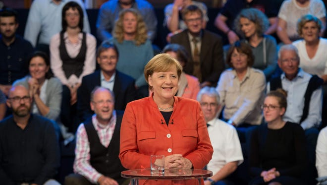 """German Chancellor Angela Merkel, the Christian Democratic Union's main candidate for the chancellorship, answers questions at the Gollan cultural facility in the TV studio of the """"Wahlarena"""" in Lübeck, Germany, on Sept. 11, 2017."""