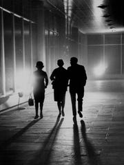 With portable truck lights illuminating the way, passengers arrive at Monroe County Airport during the November 1965 blackout.