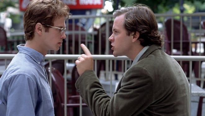 "Editor Chuck Lane (Peter Sarsgaard, right) confronts Stephen Glass (Hayden Christensen) in 2003's ""Shattered Glass."""