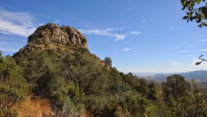 The sun shines brightly over Thumb Butte near Prescott.