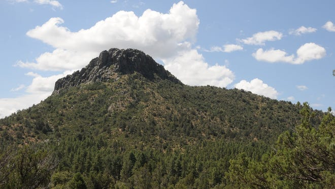 Thumb Butte rises above the  Pine Lakes Trail and Willow Creek in Prescott