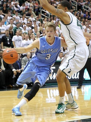 Columbia guard Grant Mullins drives to the basket against Michigan State guard Denzel Valentine on Nov. 15, 2013.