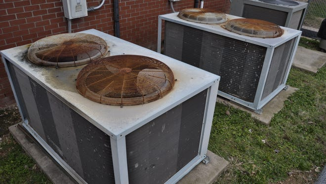 Both of these heating units at Amanda Gist Elementary School in Cotter will have to be replaced, one sooner than the other after one unit failed recently. School officials hope to have heat back on in two classrooms and the library by the time kids return from holiday break on Jan. 5.