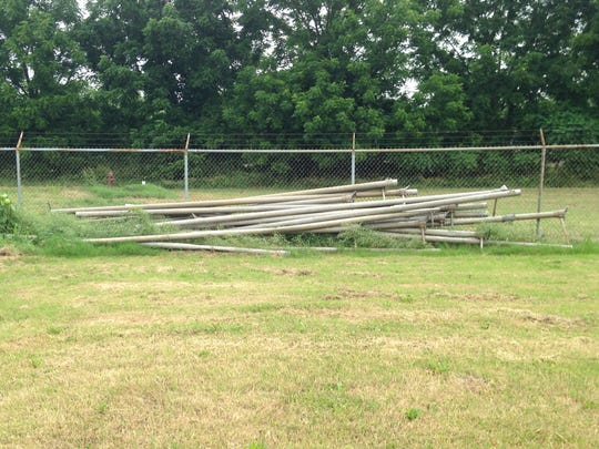 Gus Malzahn moved many of these same water pipes while at Hughes High School. They now sit along the eastern fence of the field.