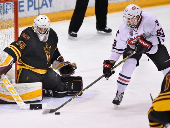 St. Cloud State's Patrick Russell controls the puck