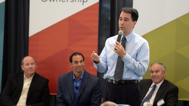 Gov. Scott Walker speaks at the Schreiber corporate headquarters dedication Monday, Sept. 15.