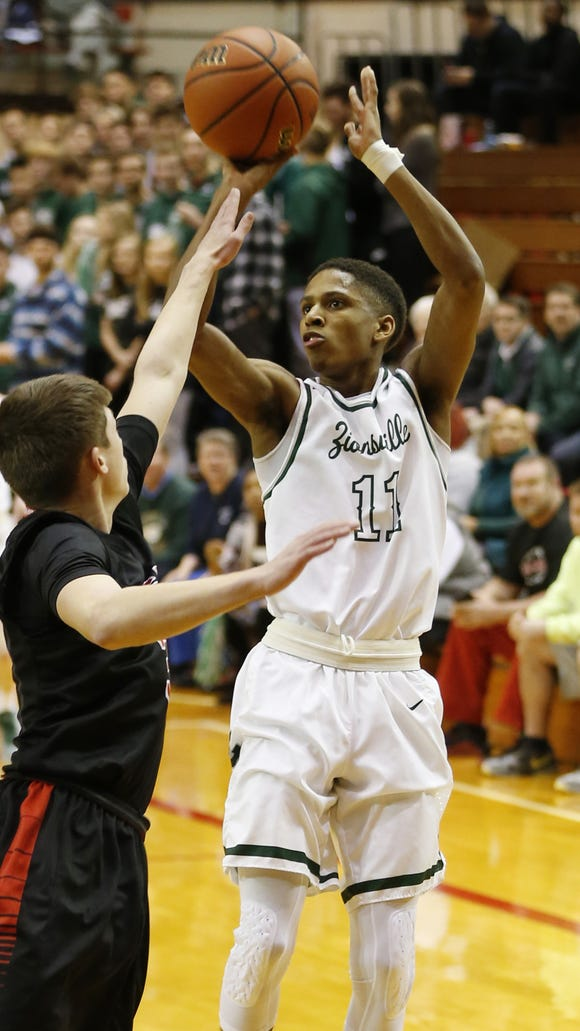 Isaiah Thompson of Zionsville puts up a shot over Sam