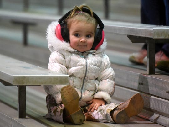 Allison Brimhall, 1, watches the Kicker Monster Truck Mania event Friday at the McGee Park Coliseum.