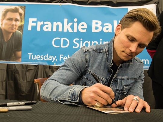 "Country musician Frankie Ballard  returned home for the debut of his new album ""Sunshine & Whiskey.""  Ballard signed CD's for many of his fans at Walmart in Battle Creek."