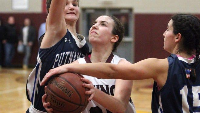 Valhalla's Shelby Sekinski drives between Putnam Valley's Arianna Stockinger, left, and Morgan Winogradoff during their Section 1 Class B girls basketball quarterfinal at Valhalla Feb. 22, 2017. Valhalla won 41-40.