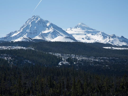 McKenzie Pass Scenic Bikeway follows Highway 242. It's a popular spot during spring for bike riders because ODOT plows it but keeps it closed to cars until June 16.  There are many views of the Three Sisters covered in snow.