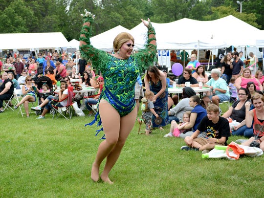 Harmony Breeze performs during the drag parade at the NEWPride Alive event Saturday at Joannes Park in Green Bay.