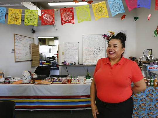 Sulma Hernandez poses for a portrait in her restaurant, Paradise Food, Friday in Manitowoc.