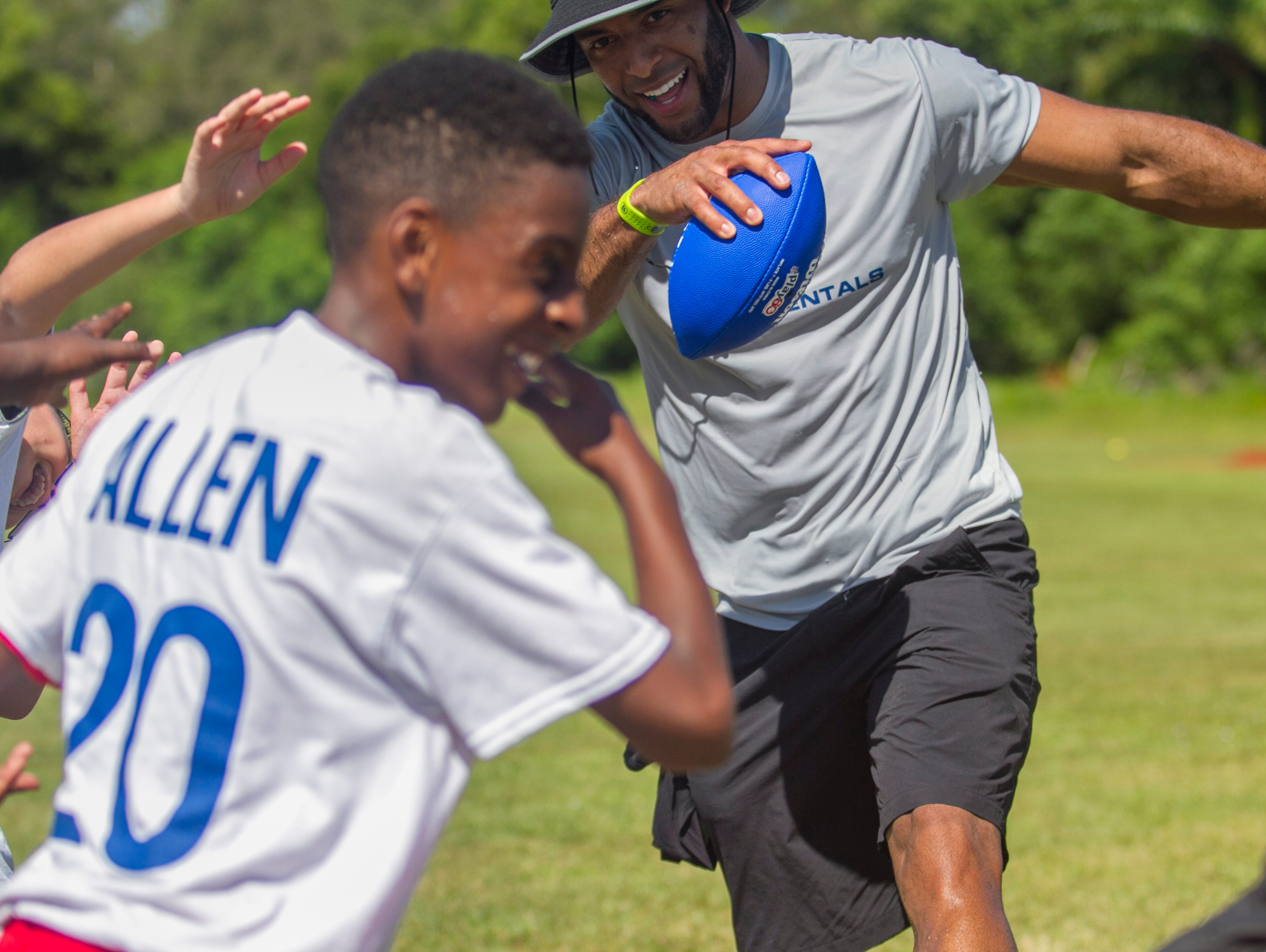 Nate Allen dabs with a group during his free youth football camp at McGregor Baptist Church on Saturday in Fort Myers.