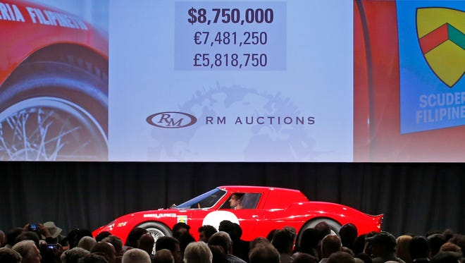 The 1964 Ferrari 250 LM sells for $8,750,000 plus 10% for a final sale price of 9,625,000 at the RM Auctions event Saturday, Jan. 16, 2015 at the Arizona Biltmore Resort & Spa in Phoenix, Ariz.
