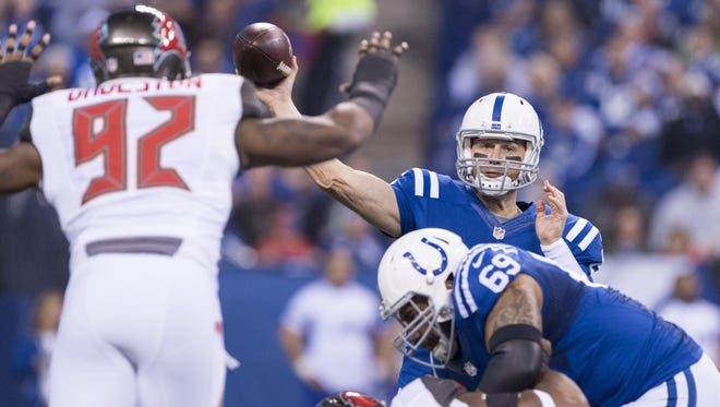 Indianapolis Colts quarterback Matt Hasselbeck (8) attempts a pass that is knocked down by Tampa Bay Buccaneers defensive end William Gholston (92) during the first half of an NFL football game Sunday, Nov. 29, 2015, at Lucas Oil Stadium.