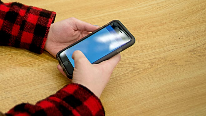 PHOTO ILLUSTRATION; Swain High School has held student assemblies to address concerns over the use of the After School app, a mobile phone app for students to post in an open forum anonymously.