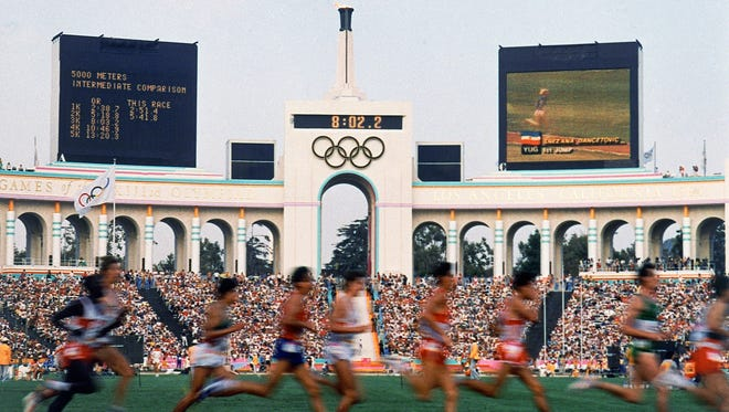 In this Aug. 1984 file photo, competitors run in the men's 5,000 meters at the Olympic Games in Los Angeles.