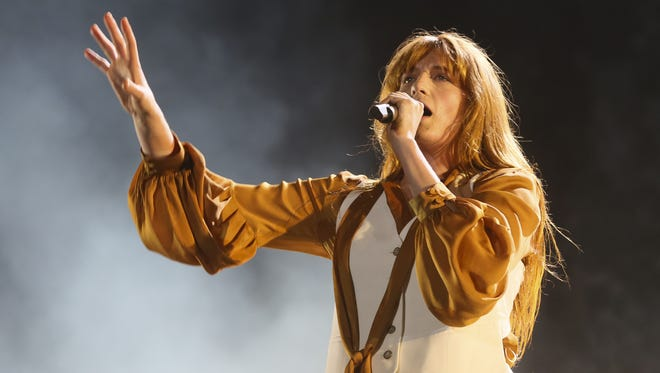 Florence Welch and her band, Florence + the Machine FILE - In this Oct. 11, 2015 file photo, Florence Welch of Florence + the Machine performs at the Austin City Limits Music Festival in Austin, Texas. Fl