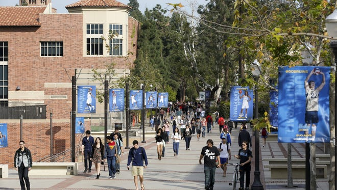 Students walk on the UCLA campus in Los Angeles in this file photo.