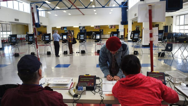 Voters cast their ballot during Nevada's Primary Election at Reno High School on June 14, 2016.