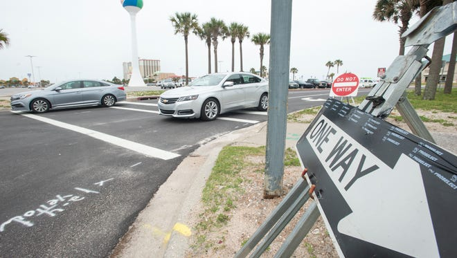 Cars follow the new one way traffic pattern coming out of the Casino Beach parking lot in Pensacola on Tuesday, May 30, 2017.