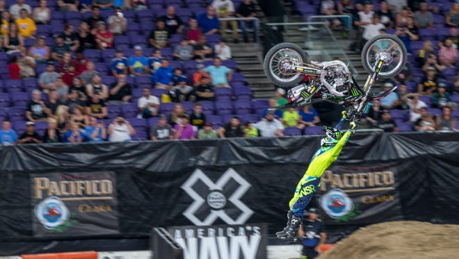 A motocross rider hangs midair during X Games competition.