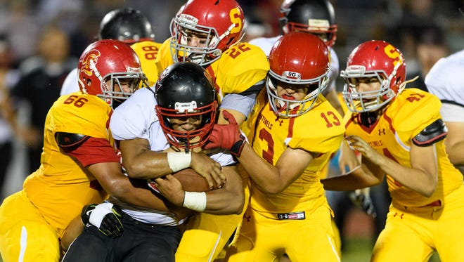 Combs' Sonatane Taunima (#44) goes nowhere against the Seton Catholic defensive line in the fourth quarter of their high school football game on Friday, Sept. 15, 2017, at Seton Catholic High School in Chandler, Ariz.