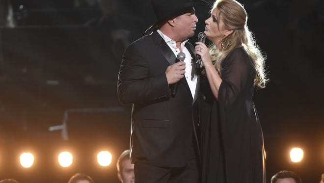 Trisha Yearwood (right) is now being billed as playing with her husband, headliner Garth Brooks, at the Stagecoach festival in April. Tickets go on sale Friday.