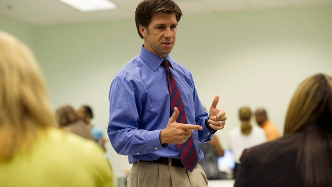 """St. Lucie County Commissioner Tod Mowery was serving as a member of the canvassing board in 2012 when he explained the recount process during a hand recount of ballots for the District 4 council seat at the Supervisor of Elections office in Fort Pierce. In December, Mowery resigned his $79,520-per-year County Commission position effective Jan. 1, citing """"deeply private issues."""""""