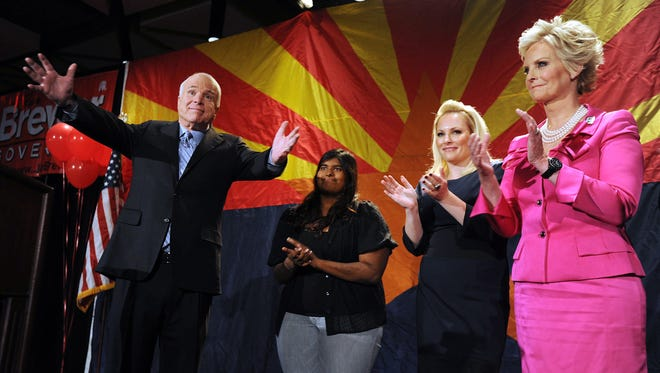 Sen. John McCain (left), R-Ariz., speaks to the crowd with his wife Cindy McCain (right) and daughters Meghan McCain (second from right) and Bridget McCain during an Arizona Republican Party Election Night event at the Hyatt Regency Nov. 2, 2010, in Phoenix. McCain easily defeated his opponent Democratic candidate Rodney Glassman.