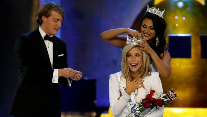 Miss America 2014 Nina Davuluri, top right, crowns Miss New York Kira Kazantsev as Miss America 2015 during the Miss America 2015 pageant, Sunday, Sept. 14, 2014, in Atlantic City, N.J. (AP Photo/Mel Evans)