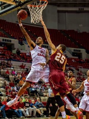 UL's Shawn Long (21) goes to the basket against Loyola's Robert White in the Cajuns' win Wednesday night.