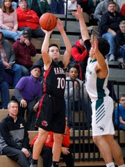 Marshall's Wyatt Crow, left, shoots against Williamston's