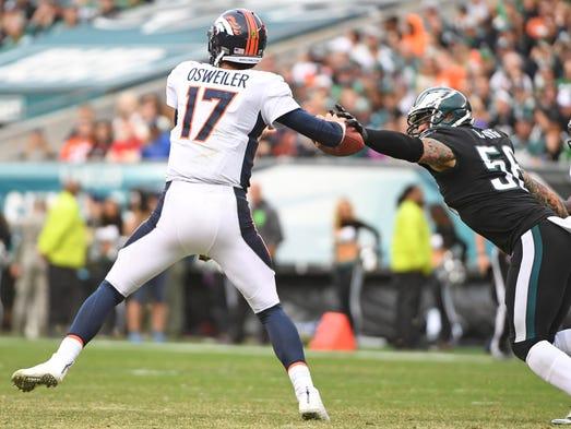 Denver Broncos quarterback Brock Osweiler is stripped