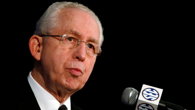 In this July 14, 2014, file photo, Southeastern Conference  Commissioner Mike Slive speaks during SEC media days in Hoover, Ala. Thanks to the successful debut of the SEC Network, the conference generated an NCAA-record $455.8 million in revenue in 2014-15. The league's revenue was $309.6 million last year. The SEC will distribute $31.2 million to each of its 14 schools, a figure that does not include $19 million in bowl revenue. Slive announced the record payout Friday, May 29, 2015, the final day of the league's spring meetings.