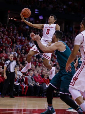Wisconsin guard D'Mitrik Trice, the Badgers' top reserve, goes to the hoop against UW-Green Bay.