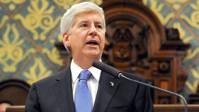 Michigan Governor Rick Snyder speaks during his State of the State Address on the floor of the House at the Capitol in Lansing on Tuesday, Jan. 20, 2015,