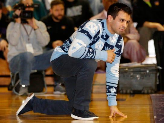 North Carolina assistant coach Tony Ramos watches a