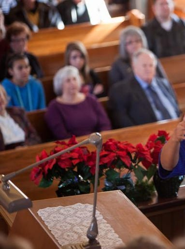 Lily Alo, of Shepherd of the Hills United Methodist Church, directs an interfaith choir during the Prayer Over the City at the St. George Tabernacle.