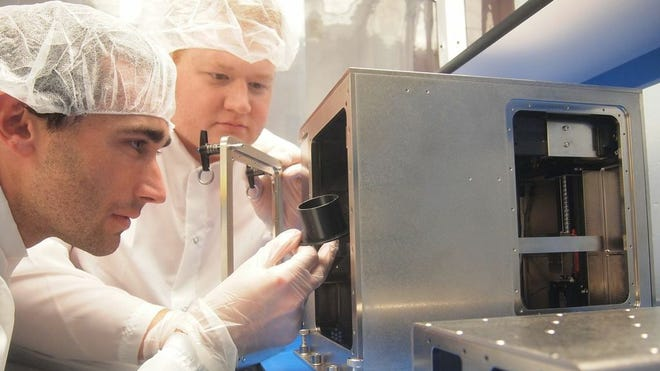 Made in Space officials Jason Dunn (left) and Mike Snyder look to optimize the first 3D printer for space. The printer will travel to the space station in SpaceX's Dragon spacecraft.
