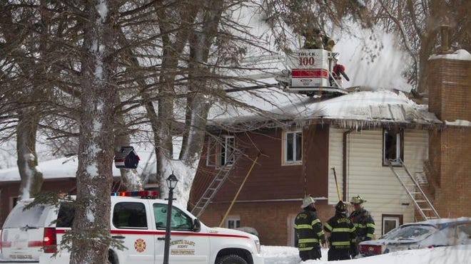 Firefighters work on a housefire at 1403 Plank Road.