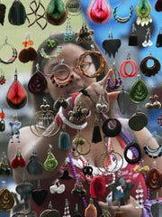 Michelle Williams finds some earrings she likes while shopping at the African Street Festival. This year's festival is Sept. 19-21 at Hadley Park.