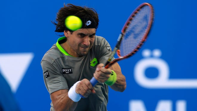 David Ferrer hits a return to Rafael Nadal during their semi-final match at the Mubadala World Tennis Championship in Abu Dhabi.
