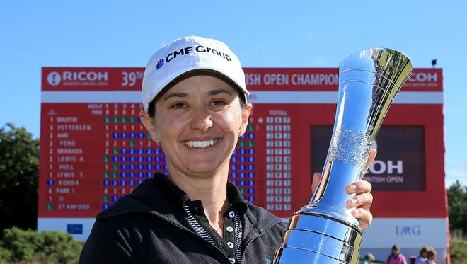 Mo Martin of the USA proudly holds the trophy after her victory during the final round of the 2014 Ricoh Women's British Open at Royal Birkdale on July 13, 2014 in Southport, England.