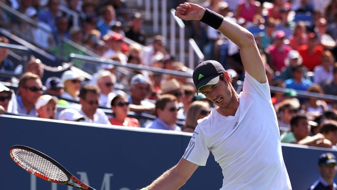 Andy Murray stretches while playing Robin Haase during their match at the U.S. Open in New York, on Monday.